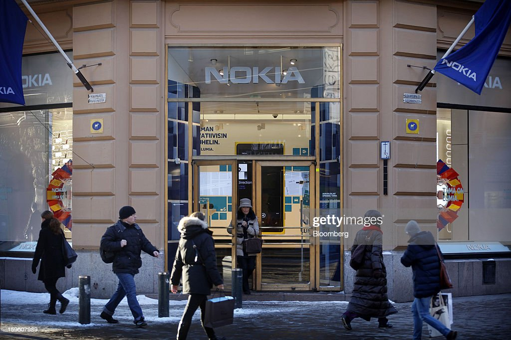 A customer exits a Nokia Oyj store in Helsinki, Finland, on Thursday, Jan. 17, 2013. The pace of Finland's debt growth is alarming and the country must undertake economic reforms together with reining in spending, Finnish Prime Minister Jyrki Katainen said in an op-ed piece published in newspaper Savon Sanomat. Photographer: Ville Mannikko/Bloomberg via Getty Images