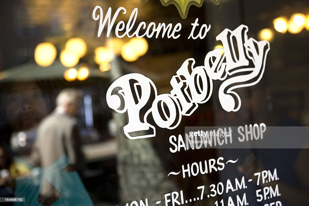 A customer exits a Potbelly Sandwich Shop in Washington, D.C., U.S., on Tuesday, Oct. 15, 2013. Potbelly Corp., the Chicago-based purveyor of made-to-order toasted sandwiches, held its initial public offering (IPO) on Oct. 4. Photographer: Andrew Harrer/Bloomberg via Getty Images