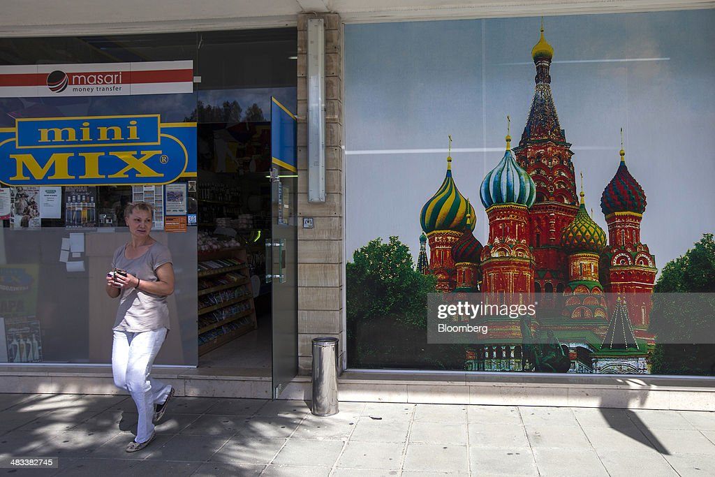 A customer exits a Russian mini supermarket store in Limassol, Cyprus, on Tuesday, April 8, 2014. Cyprus is the biggest foreign investor in Russia with $69 billion dollars accumulated through the end of last year, while the island is the second-biggest destination for Russian investment at $33 billion, according to the Moscow-based Federal Statistics Service. Photographer: Andrew Caballero-Reynolds/Bloomberg via Getty Images