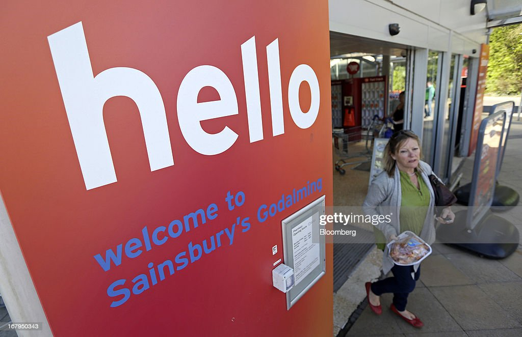 A customer exits a Sainsbury's supermarket store, operated by J Sainsbury Plc, in Godalming, U.K., on Thursday, May 2, 2013. J Sainsbury Plc, the U.K.'s third-largest supermarket chain, will report full year results on May 8. Photographer: Chris Ratcliffe/Bloomberg via Getty Images