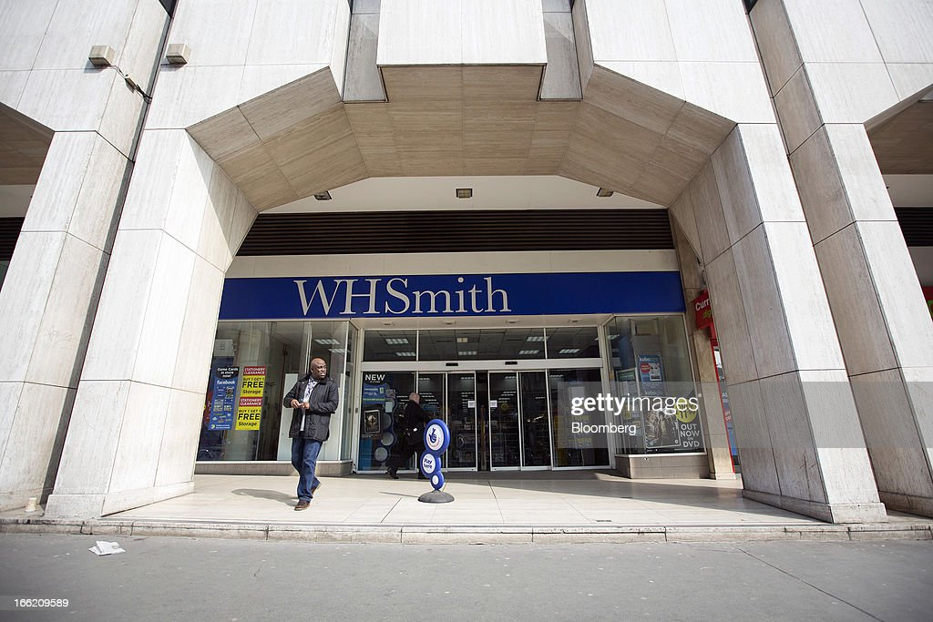 A customer exits a WH Smith Plc store in London, U.K., on Wednesday, April 10, 2013. WH Smith Plc, the book and magazine retailer with more than 1,100 U.K. outlets, is scheduled to announce earnings on April 11. Photographer: Simon Dawson/Bloomberg via Getty Images