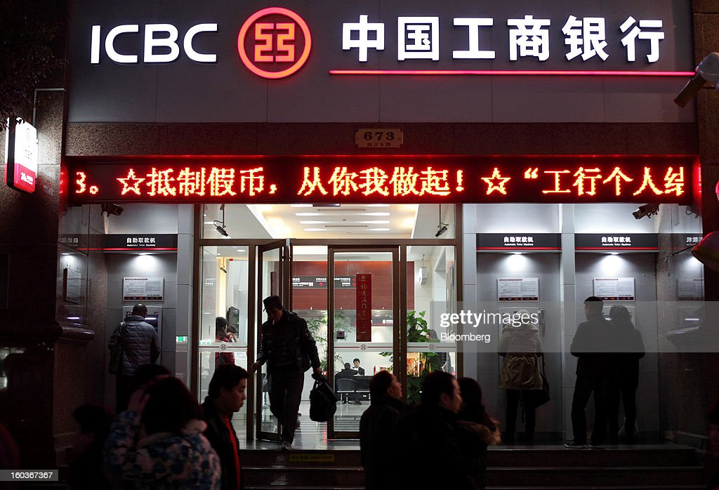 A customer exits an Industrial and Commercial Bank of China Ltd. (ICBC) bank branch at night in Shanghai, China, on Tuesday, Jan. 29, 2013. China's economic growth accelerated for the first time in two years as government efforts to revive demand drove a rebound in industrial output, retail sales and the housing market. Photographer: Tomohiro Ohsumi/Bloomberg via Getty Images