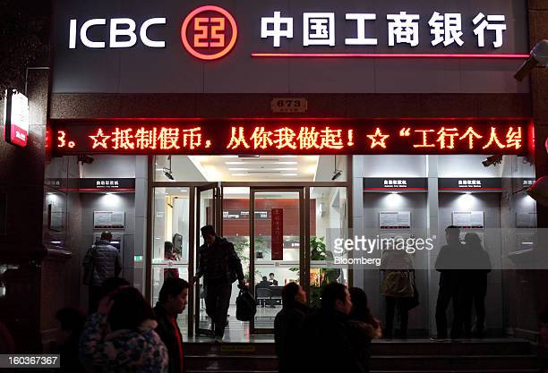 A customer exits an Industrial and Commercial Bank of China Ltd bank branch at night in Shanghai China on Tuesday Jan 29 2013 China's economic growth...