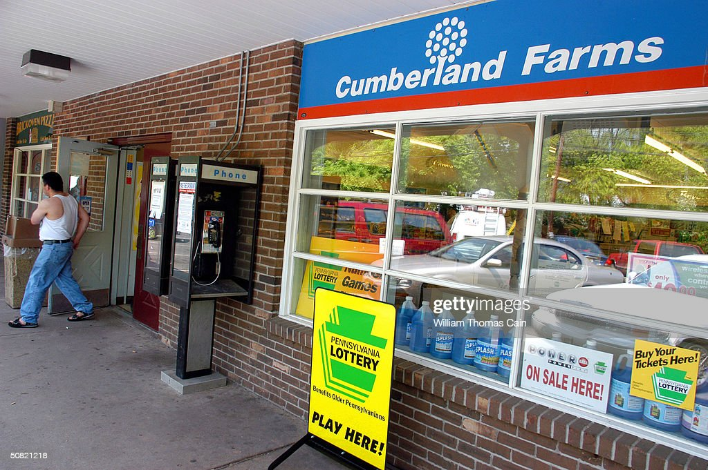 A customer exits Cumberland Farms convenience store May 10, 2004 in Washington Crossing, Pennsylvania. The winner of the May 8th $213 million dollar Powerball jackpot has yet to come forward. For selling the winning ticket, the Cumberland Farms store will receive $400,000.