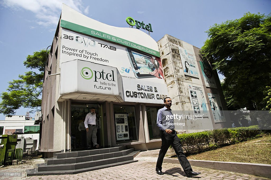 A customer exits the Pakistan Telecommunications Co. (PTCL) sales and customer care center in Islamabad, Pakistan, on Wednesday, Aug. 21, 2013. Pakistan Telecommunication, the countrys biggest fixed-line phone-service provider, said second-half sales growth will at least match the pace of the previous six months as broadband demand increases. Photographer: Asad Zaidi/Bloomberg via Getty Images