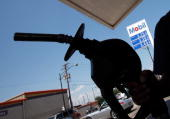 A customer feuls her car at an Exxon Mobil gas station July 29 2010 in Chicago Illinois Exxon Mobile's quarterly profits were released July 27...