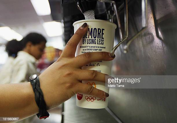 A customer fills a 21 ounce cup with soda at a 'McDonalds' on September 13 2012 in New York City In an effort to combat obesity the New York City...