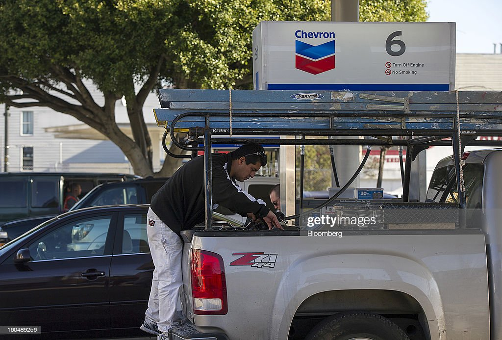 A customer fills a gasoline can with fuel at a Chevron Corp. station San Francisco, California, U.S., on Friday, Feb. 1, 2013. Chevron Corp., the second-largest U.S. energy company, said fourth-quarter profit increased 41 percent to a record $7.25 billion as it reported stronger refining results and a gain from an Australian natural gas field swap. Photographer: David Paul Morris/Bloomberg via Getty Images