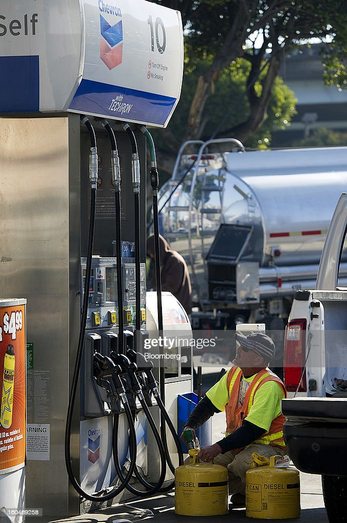 A customer fills gasoline cans with diesel fuel at a Chevron Corp. station San Francisco, California, U.S., on Friday, Feb. 1, 2013. Chevron Corp., the second-largest U.S. energy company, said fourth-quarter profit increased 41 percent to a record $7.25 billion as it reported stronger refining results and a gain from an Australian natural gas field swap. Photographer: David Paul Morris/Bloomberg via Getty Images