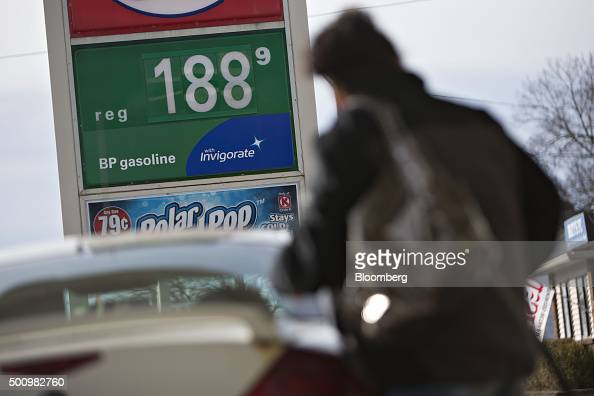 A customer fills her vehicle with fuel at a gas station in Chillicothe Illinois US on Friday Dec 11 2015 The cost of a gallon of regular gasoline...