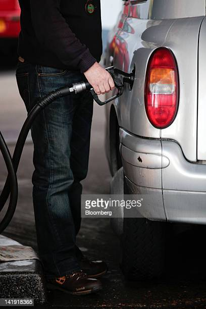 A customer fills his London taxi cab with Diesel fuel at a Shell Gas station operated by Royal Dutch Shell Plc in London UK on Monday March 26 2012...