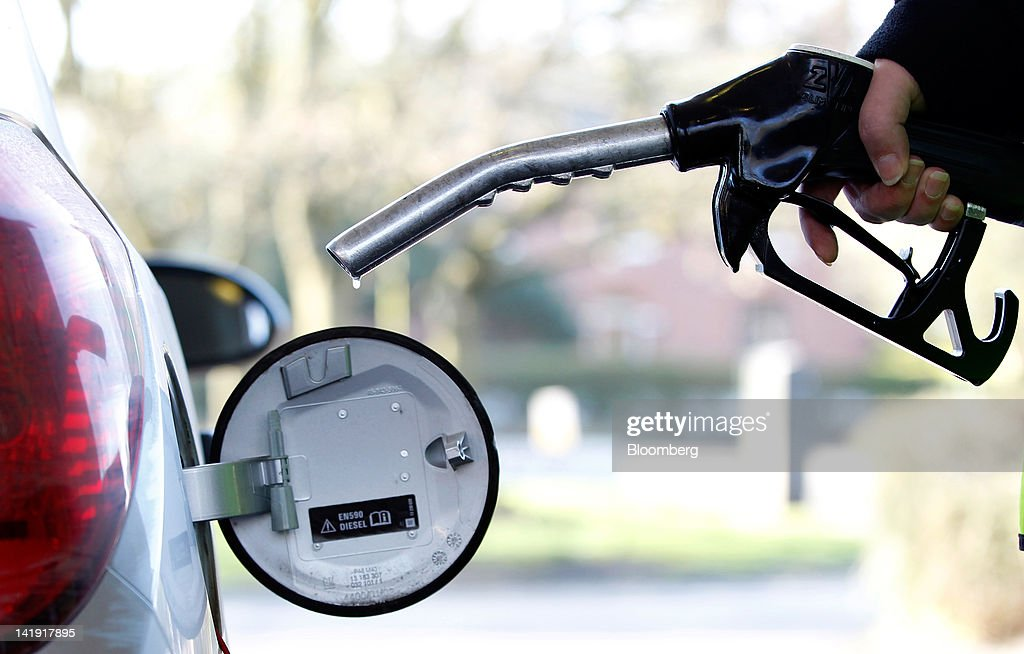 A customer fills his vehicle with Diesel fuel in this arranged photograph at a BP Plc gas station in Manchester UK on Monday March 26 2012 Fueltanker...