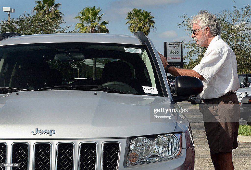 Customer Frank Barba Views The Interior Of A 2011 Jeep Compass Vehicle At  Arrigo DodgeChryslerJeep Car