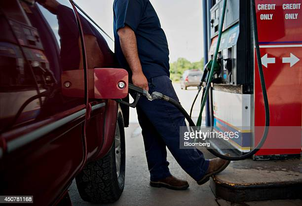 A customer fuels his vehicle at a Road Ranger gas station in Princeton Illinois US on Tuesday June 17 2014 Gasoline in the US climbed this week...