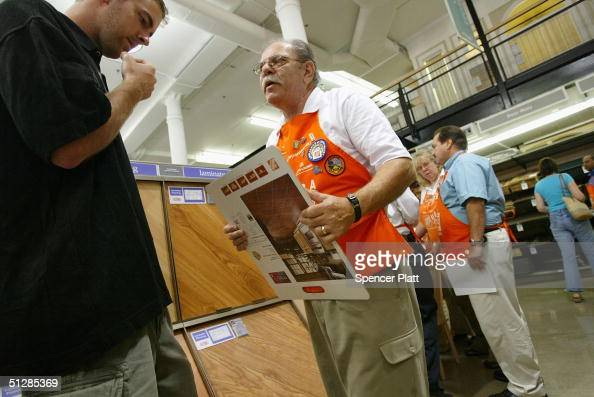 A customer gets help at the the new threelevel Home Depot megastore on West 23rd street September 10 2004 in New York City The new store which...