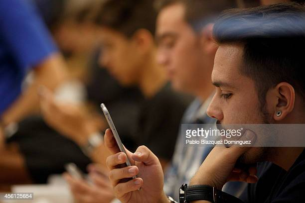 A customer gets his new iPhone set up at Puerta del Sol Apple Store as Apple launches iPhone 6 and iPhone 6 Plus on September 26 2014 in Madrid Spain...