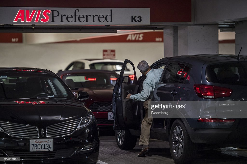 A customer gets into a vehicle in the Avis Budget Group Inc. garage at San Francisco International Airport (SFO) in San Francisco, California, U.S., on Monday, May 2, 2016. Avis Budget Group Inc. is expected to release earnings figures on May 3. Photographer: David Paul Morris/Bloomberg via Getty Images