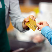 Customer Giving Clerk Credit Card