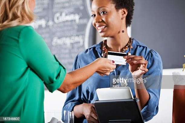 Customer handing cashier a payment card