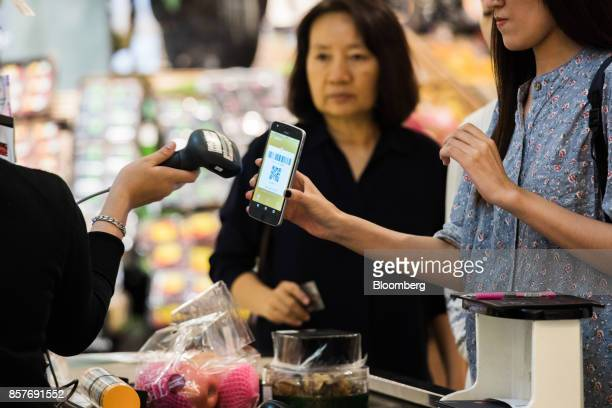 A customer has a QR code scanned from a smart phone at a grocery store in Bangkok Thailand on Thursday Sept 28 2017 SingaporeandThailandare in...