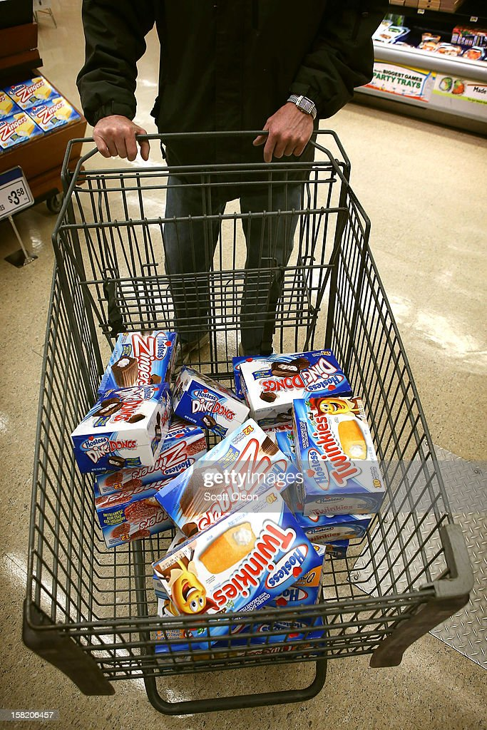 A customer heads to the checkout with a shopping cart loaded with Hostess snacks at a Jewel-Osco grocery store on December 11, 2012 in Chicago, Illinois. The Jewel-Osco grocery store chain purchased the last shipment of 20,000 boxes of Hostess products and put them on sale in their stores throughout the Chicago area today. Hostess Brands Inc. shut down its baking operations and began liquidating assets last month after failing to negotiate a labor contract with Workers with the Bakery, Confectionery, Tobacco Workers and Grain Millers International Union