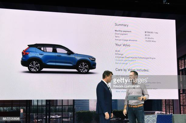 A customer Heith Rogers with his transaction shown on a large screen buys Volvo XC40 SUV as Anders Gustafsson Senior Vice President Americas...