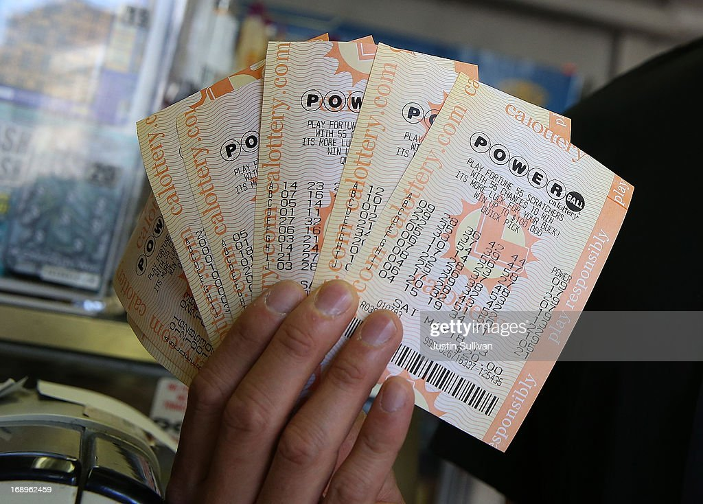 A customer holds $140 worth of Powerball tickets that he just purchased on May 17, 2013 in San Francisco, California. People are lining up to purchase $2 Powerball tickets as the multi-state jackpot hits $600 million.