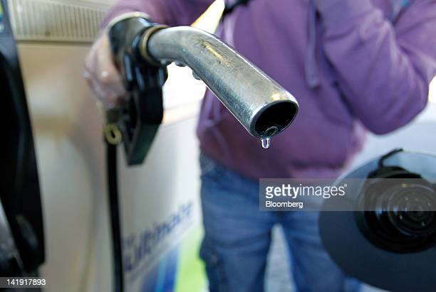 A customer holds a Diesel fuel pump in this arranged photograph while on the forecourt of a BP Plc gas station in Manchester UK on Monday March 26...