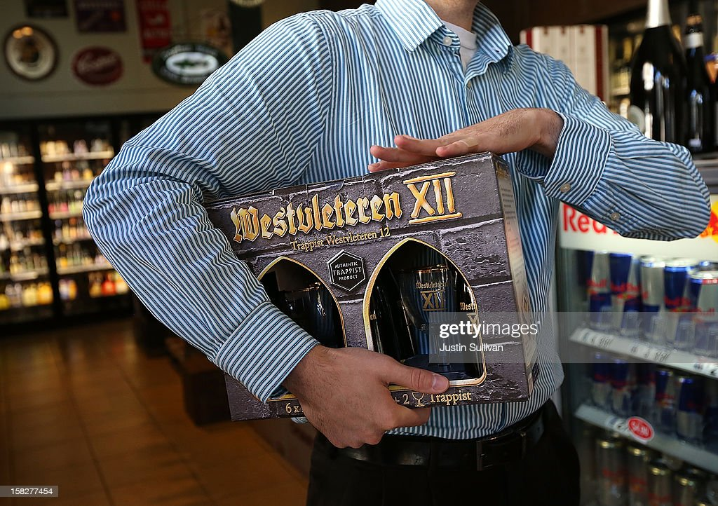 A customer holds a sixpack of Westvleteren 12 at Ales Unlimited on December 12 2012 in San Francisco California Beer connoisseurs across the United...