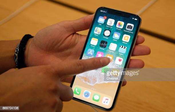 A customer holds an Apple iPhone X the new model of Apple smartphone at the Apple Store SaintGermain on November 3 2017 in Paris France Apple's...