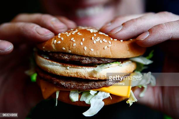 Russell Benjafield holds his Big Mac burger at a McDonald's restaurant in London UK on Monday Feb 1 2010 McDonald's Corp the world's largest...