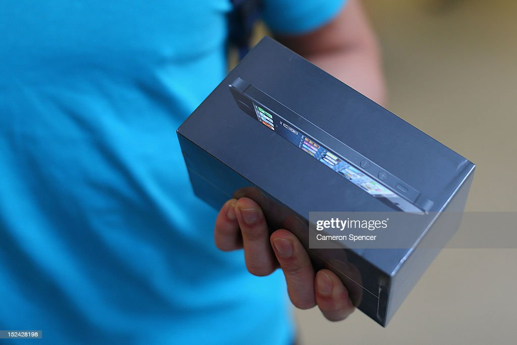A customer holds the iPhone 5 at the Apple flagship store on George street on September 21, 2012 in Sydney, Australia. Australian Apple stores are the first in the world to receive and sell the new iPhone 5 handsets.