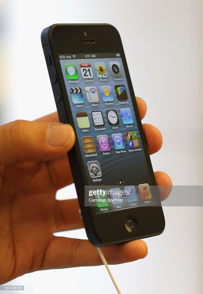 A customer holds the iPhone 5 smartphone at the Apple flagship store on George street on September 21, 2012 in Sydney, Australia. Australian Apple stores are the first in the world to receive and sell the new iPhone 5 handsets.