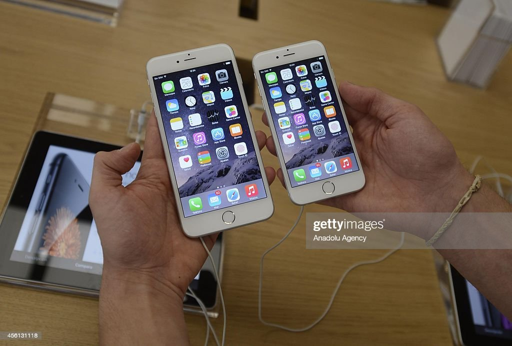 A customer holds the new products of Apple iPhone 6 and iPhone 6 Plus at an Apple Store in Madrid Spain on September 26 2014 The iPhone 6 and iPhone...