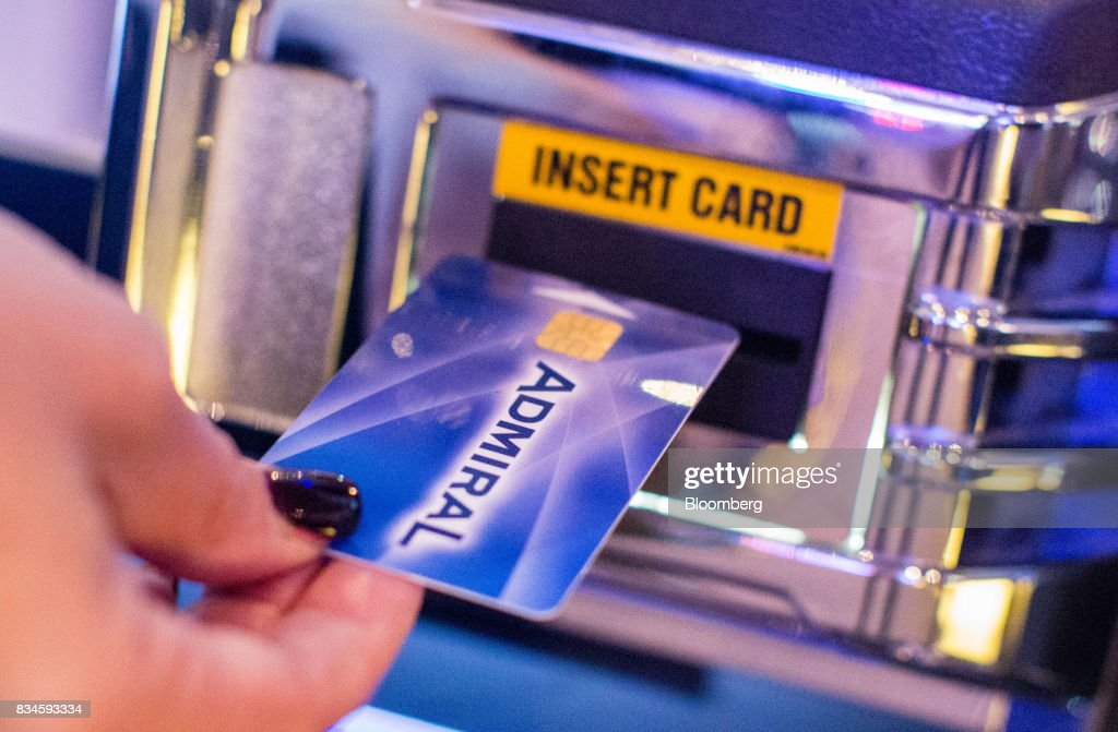 A customer inserts an electronic identification card into a gaming machine inside an Admiral Casinos & Entertainment AG casino, operated by Novomatic AG, in Wiener Neudorf, Austria, on Thursday, Aug. 17, 2017. Novomatic is preparing for an initial public offering that could value the Austrian casino and gaming business at about 6 billion euros ($6.3 billion), according to people familiar with the matter. Photographer: Lisi Niesner/Bloomberg via Getty Images