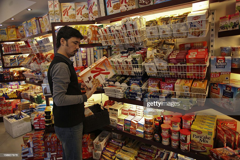 A customer inspects a box of Kellogg Co. cereal at Shams supermarket in Islamabad, Pakistan, on Sunday, Dec. 30, 2012. Pakistan's economy will probably expand 3.5 percent in the 12 months through June, the International Monetary Fund forecast Nov. 29, less than the 4.3 percent predicted by the government. Photographer: Asad Zaidi/Bloomberg via Getty Images