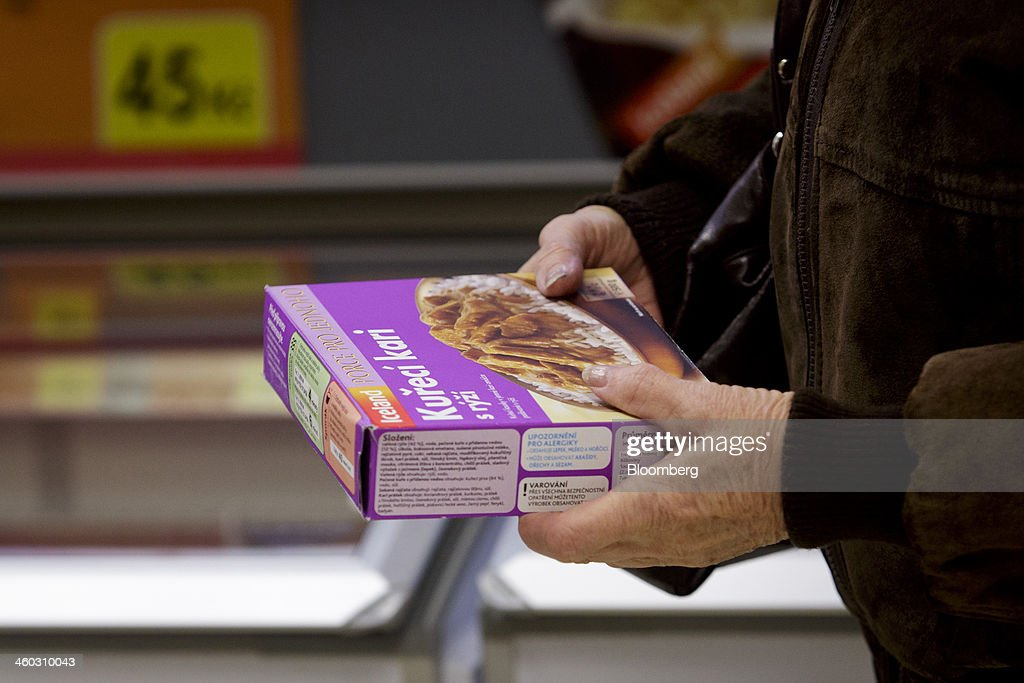 A customer inspects a frozen chicken ready-meal inside an Iceland Foods Ltd. store in Prague, Czech Republic, on Friday, Jan. 3. 2014. The Czech Republic's 2013 budget deficit of 80.9 billion koruna ($4.01 billion) beat the 100 billion-koruna target after the government cut spending, the Finance Ministry said. Photographer: Martin Divisek/Bloomberg via Getty Images