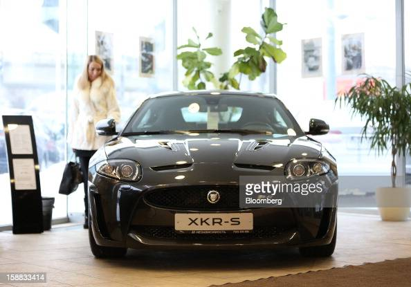 A customer inspects a Jaguar XKRS series automobile on display at an independent auto showroom in Moscow Russia on Friday Dec 28 2012 Tata Motors...