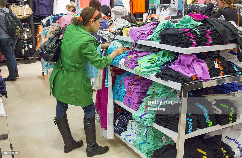 A customer inspects fashion clothing on display inside a Primark store on Oxford Street in central London, U.K., on Monday, April 22, 2013. Associated British Foods Plc, the owner of the Primark discount-clothing chain, fell the most in three months after Credit Suisse Group AG said it's unlikely the chain's profit growth can continue at the first half's pace. Photographer: Jason Alden/Bloomberg via Getty Images