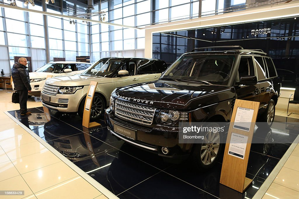 A customer inspects new Range Rover automobiles on display in an independent auto showroom in Moscow, Russia, on Friday, Dec. 28, 2012. Tata Motors Ltd.'s Jaguar Land Rover luxury unit signed a letter of intent with Saudi Arabia's government to study the feasibility of setting up a factory to build its models locally. Photographer: Andrey Rudakov/Bloomberg via Getty Images