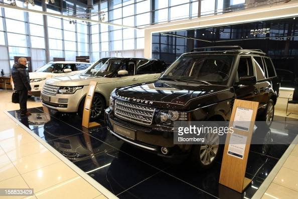 A customer inspects new Range Rover automobiles on display in an independent auto showroom in Moscow Russia on Friday Dec 28 2012 Tata Motors Ltd's...
