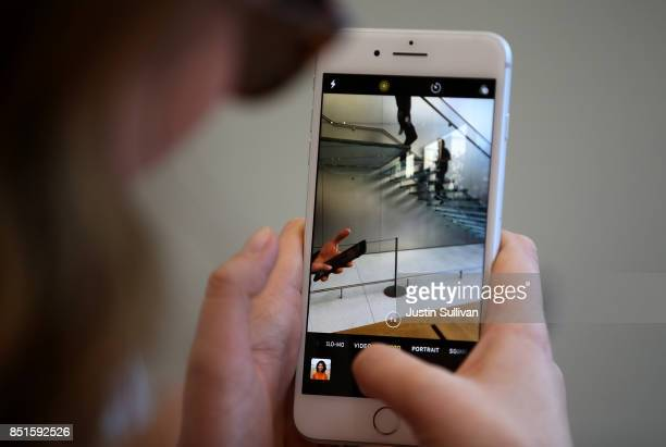 A customer inspects the new Apple iPhone 8 at an Apple Store on September 22 2017 in San Francisco California The new Apple iPhone 8 and 8 Plus as...