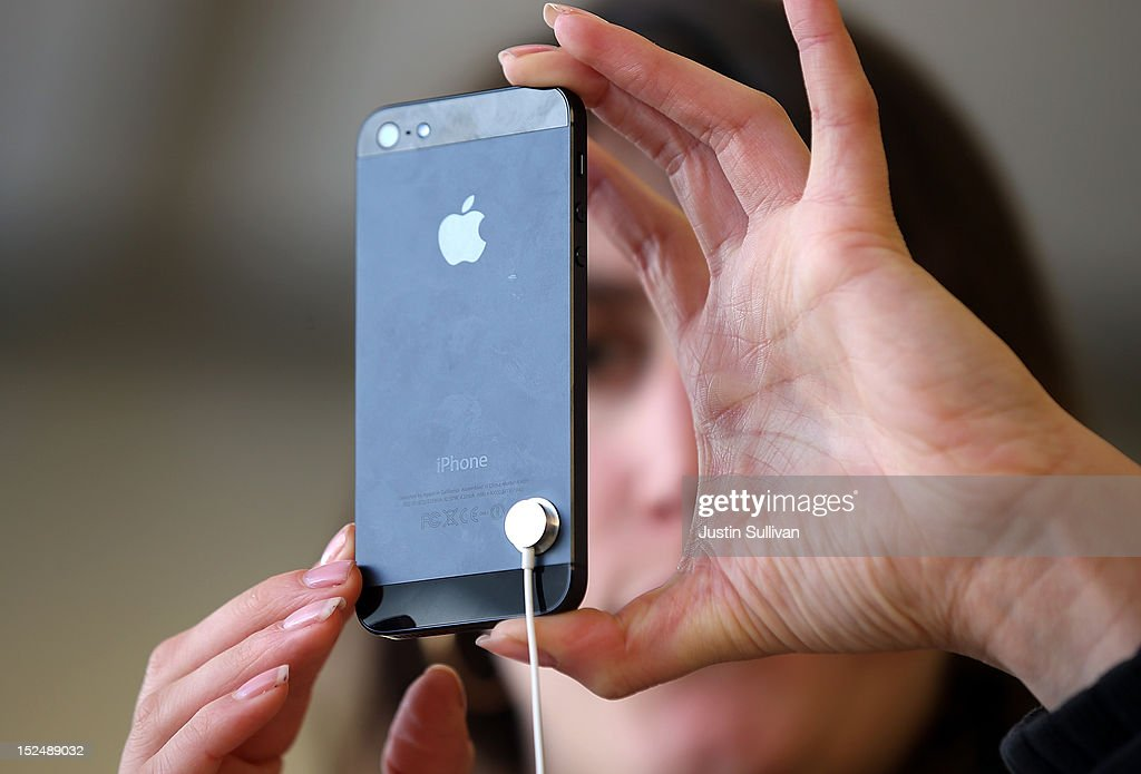 A customer inspects the new iPhone 5 at an Apple Store on September 21, 2012 in San Francisco, California. Customers flocked to Apple Stores across the U.S. to purchase the hotly anticipated iPhone 5 which went on sale nationwide today.