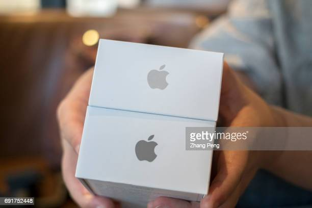 A customer is buying new iPhone According to the fiscal report of the second quarter in 2017 the total revenue of Apple amounted to $52896 billion...