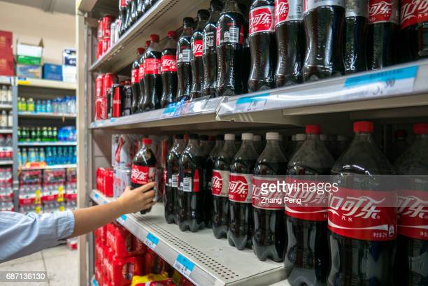A customer is choosing a CocoCola drink in a supermarket Since 2012 CocaCola's profit has declined year after year At the end of April 2017 according...