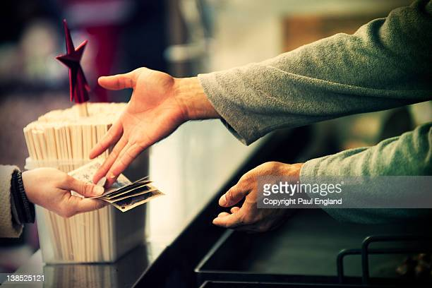 Customer is given change at food stand