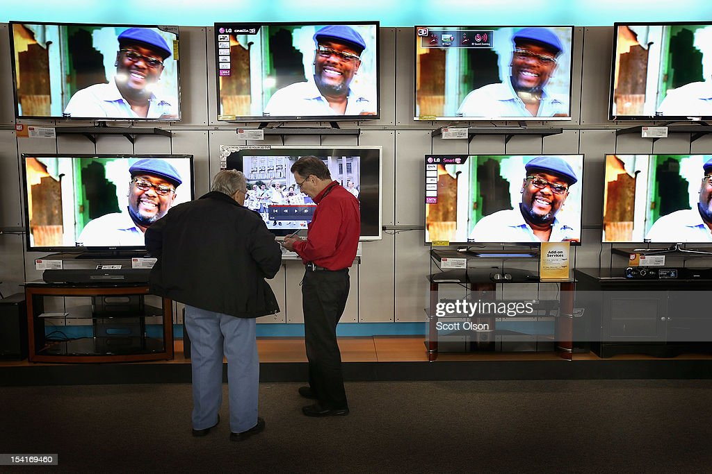 A customer is helped as he looks over televisions being offered for sale at an hhgregg store on October 15, 2012 in Niles, Illinois. Retail sales rose 1.1 percent last month with electronics and appliances leading the way with a 4.5 percent increase in sales.