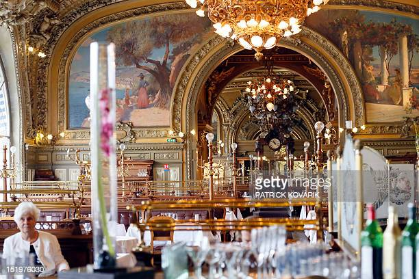 A customer is seated in the main room of the 'Train Bleu' restaurant on September 14 2012 at the Gare de Lyon in Paris The restaurant initially...