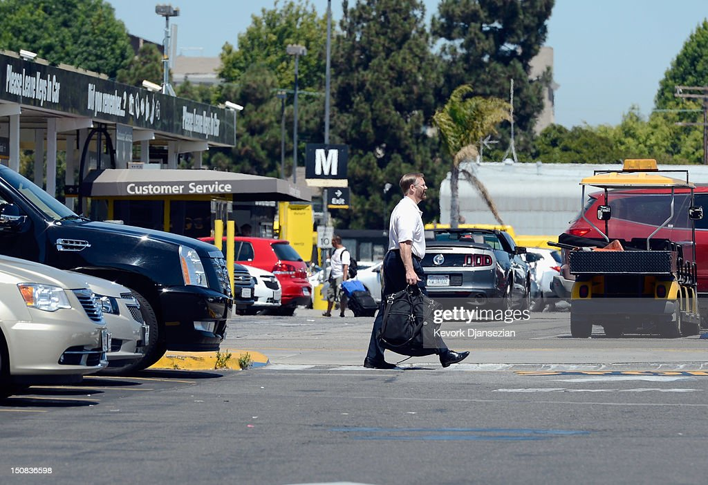 A Customer is seen inside Hertz Global Holdings car rental branch August 27, 2012 in Los Angeles, California. Two major rental car companies agreed to merge as Hertz Global Holdings announced it is acquring Dollar Thrifty Automotive Group for $2.3 billion.