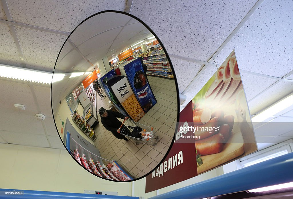 A customer is seen pushing a shopping cart inside a supermarket operated by OAO Dixy Group in Moscow, Russia, on Friday, Feb. 22, 2013. Russia's largest retailer by market value, OAO Magnit, is spending as much as $1.8 billion this year to compete against X5 Retail Group NV and OAO Dixy Group. Photographer: Andrey Rudakov/Bloomberg via Getty Images